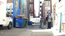 teens smoking cigarettes in an alley
