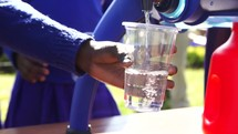 pouring filtered water into a cup