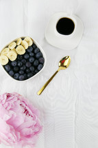 peonies and bowl of fruit with coffee