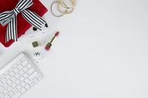 lipstick, computer keyboard, desk, home office,, gift, bells, present, white background, Christmas, bows, back, earrings, gold, feminine, makeup