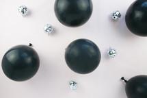 black balloons and mirrored disco balls
