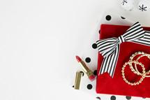 lipstick, earrings, bracelets,  makeup, presents,  polka dots, gold, red, black, white, white background
