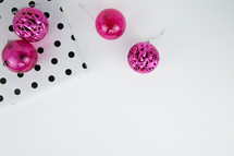 pink ornaments and black and white polka dot wrapping aper