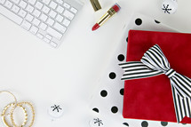 lipstick, computer keyboard, desk, home office,, gift, bells, present, white background, Christmas, bows, back, earrings, gold, feminine, makeup