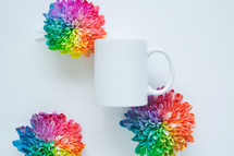 rainbow flowers and a white mug