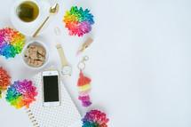 rainbow flowers, journal, cellphone, watch, gold, rings, spoon, tea, white background, lipstick, spring, desk