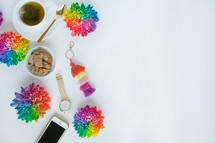 rainbow flowers, cellphone, watch, tea