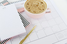 latte on a planner and notepad