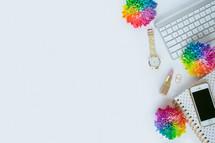 rainbow flowers computer keyboard, watch, lipstick, cellphone, journal