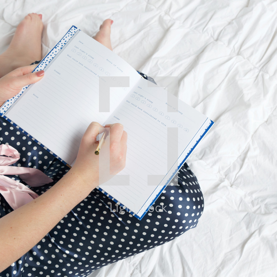 a woman writing in a sleep journal