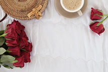 red roses and woven basket