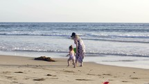 mother and toddler on a beach