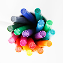 markers in a cup on a white background
