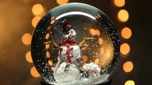 snow globe with a snowman and bokeh lights