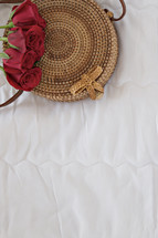 red roses on a woven basket
