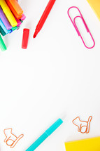 markers, and paperclips on a white background