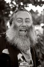 happy man with a long heavy beard