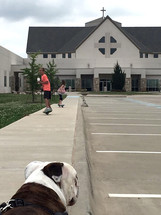 kids skateboarding in a church parking lot