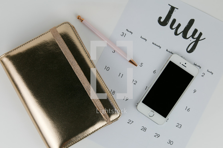 planner, calendar, pencil, and iPhone