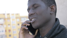 young man talking on a cellphone