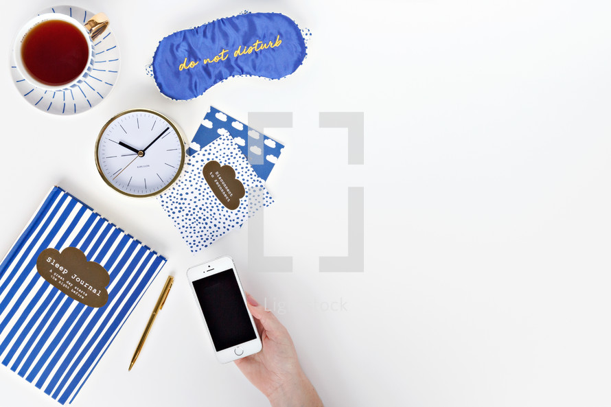 do not disturb mask, pen, sleep journal, and cards