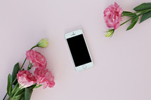 pink carnations and cellphone