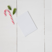 candy canes, pine boughs, and blank white paper