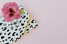 dalmatian spotted notebook, pen, and flowers in a vase
