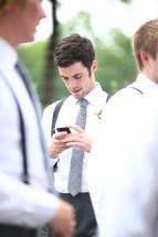 groomsmen checking his phone