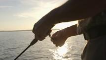 man castling a fishing pole