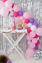 champagne and balloon arch