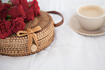 red roses on a basket and coffee cup