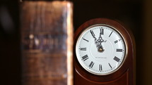 old Bible and antique clock