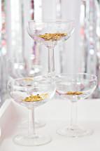 champagne glasses and star confetti