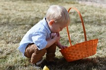 toddler with an Easter basket eating candy
