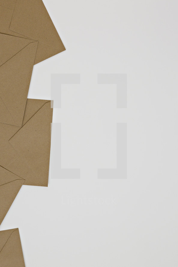 brown envelopes on white background