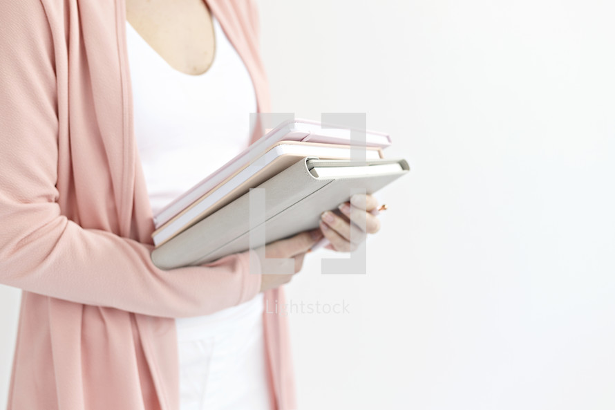 a woman holding journals
