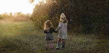 sisters standing in grass