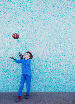 boy child catching a football
