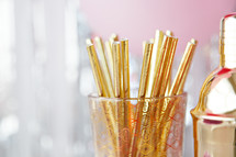 cocktail shaker and gold straws