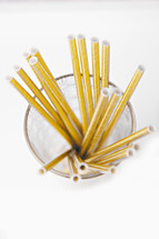 gold cocktail straws in a glass