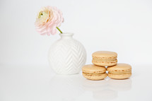 macaroons and flower in a vase