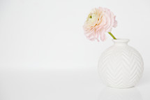 vase and single pink flower