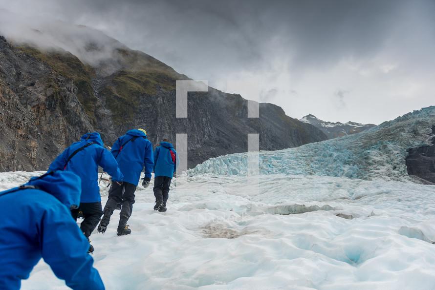 hikers on a glacier
