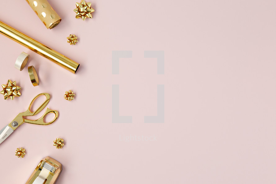 gold holiday bows and gift wrapping