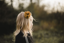 a blonde girl with a flower bow in her hair