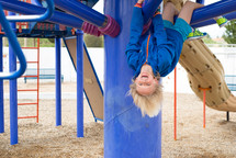 a child playing on a playground outdoors