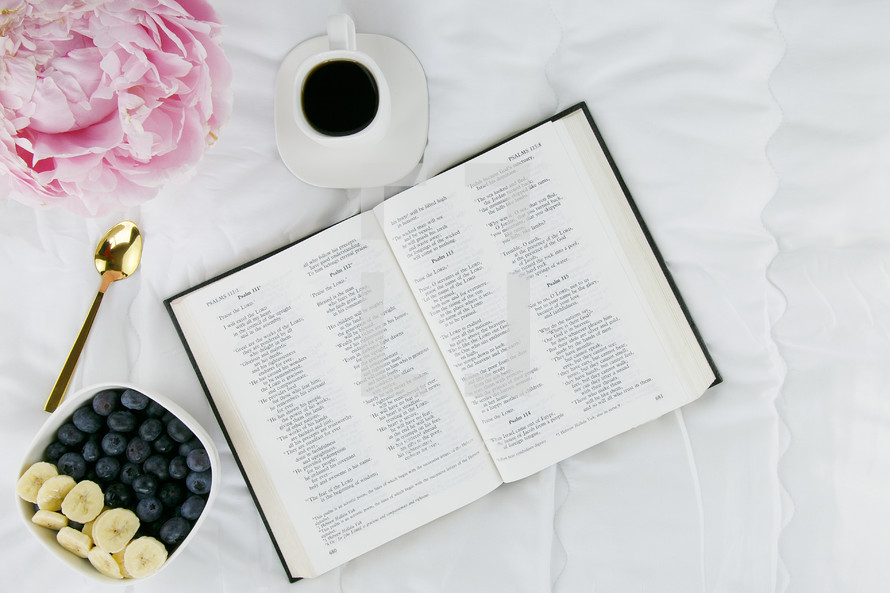 peonies, cup of coffee, bowl of fruit, and open pages of a Bible