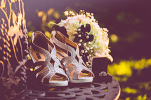 silver high heels and wedding bands