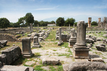 Corinthian column looking across Agora to Basilica B. Remains from historic Philippi that would have been visited by the Apostle Paul, Silas, Lydia and early Christians from Acts 16. These remains are near the Agora of Philippi.